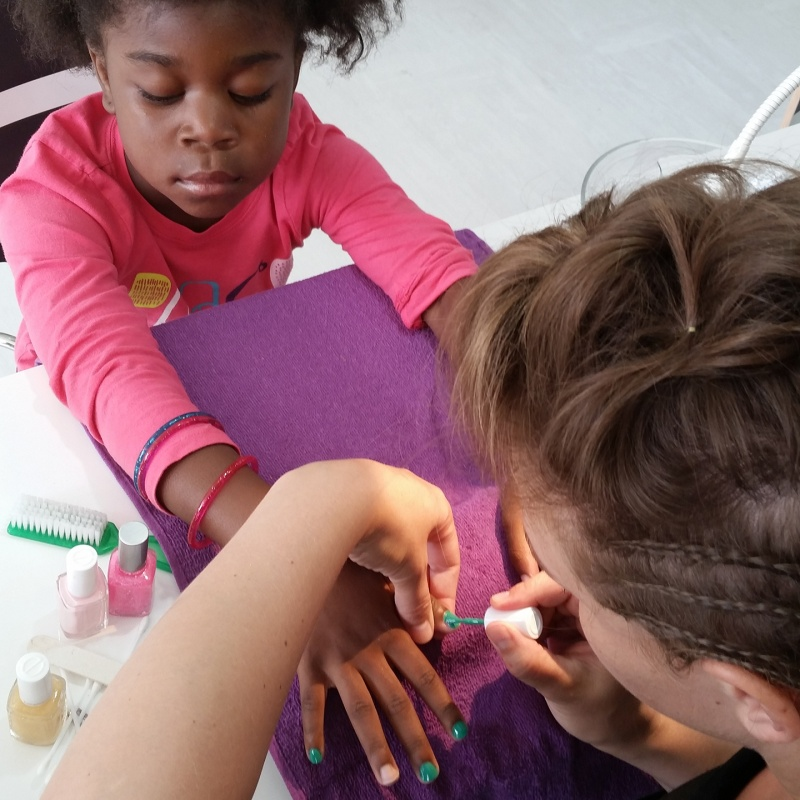 young girl getting manicure
