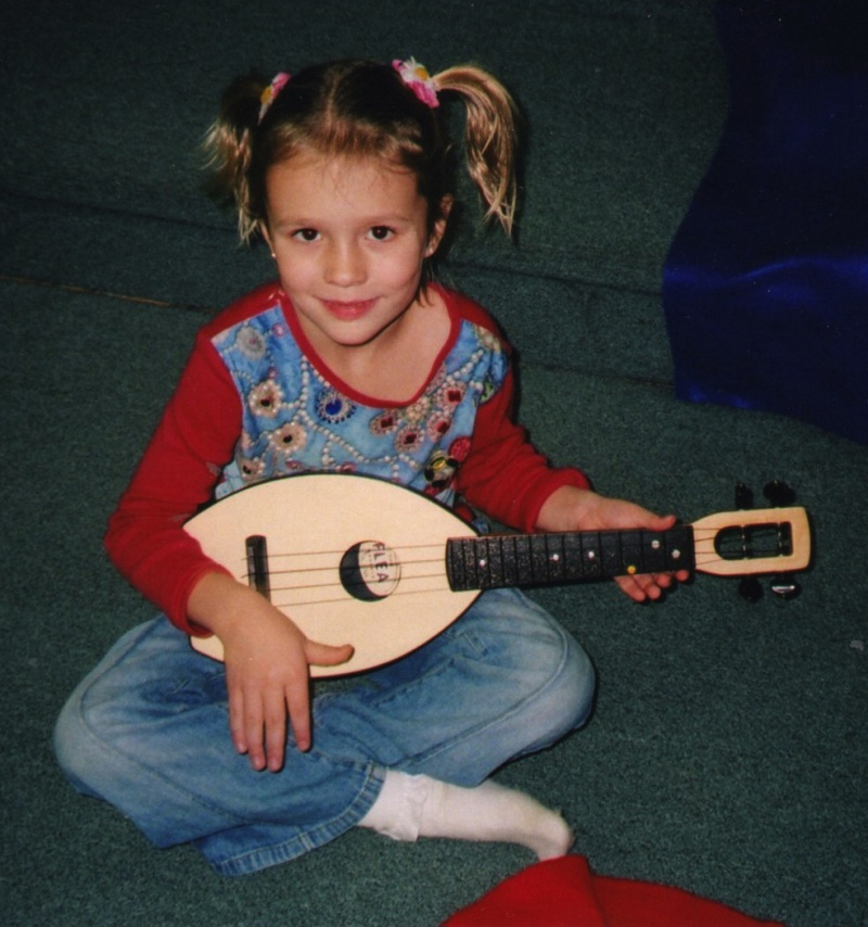young girl playing ukulele